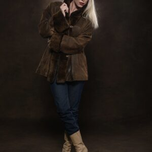 woman wearing camel break leather rex trim jacket