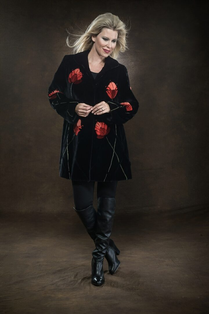 • woman wearing black fur coat with red floral design