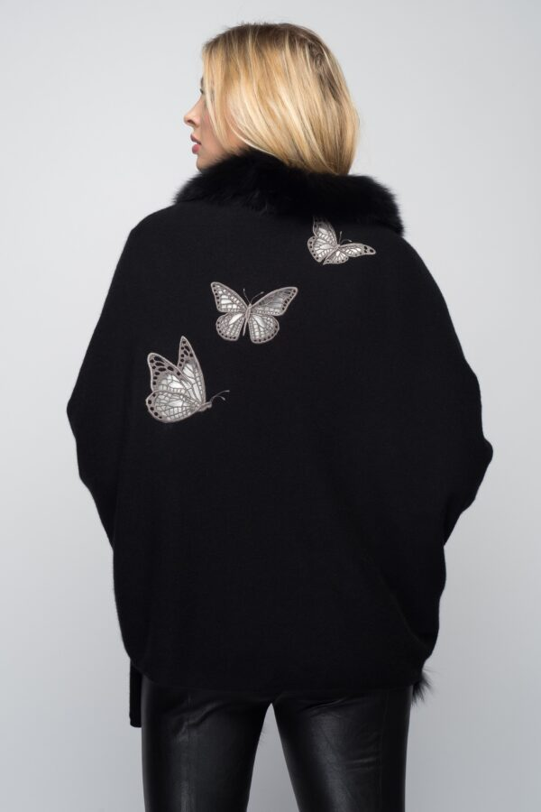 woman wearing black wrap with butterfly design