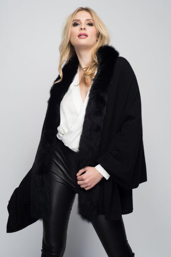 blonde woman modeling black cashmere wrap