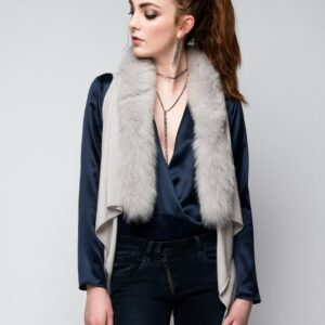 brunette woman wearing cashmere and fox gilet