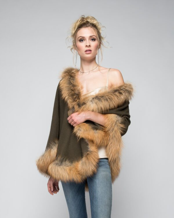 woman wearing sleeveless top and cashmere and fox cape