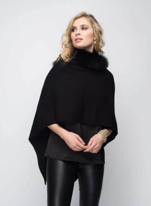 woman with blonde hair wearing black shawl with fur collar