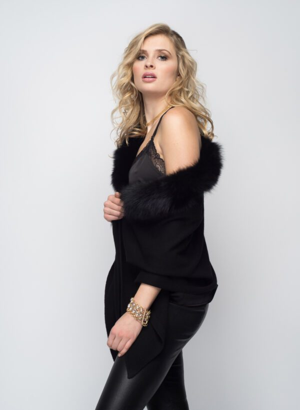 woman with blonde hair wearing black shawl with fur