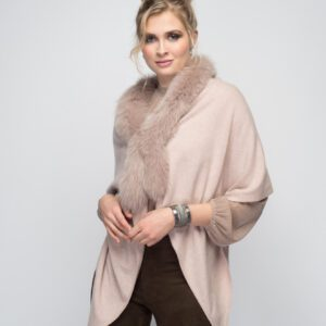blonde woman wearing cashmere and fox stole