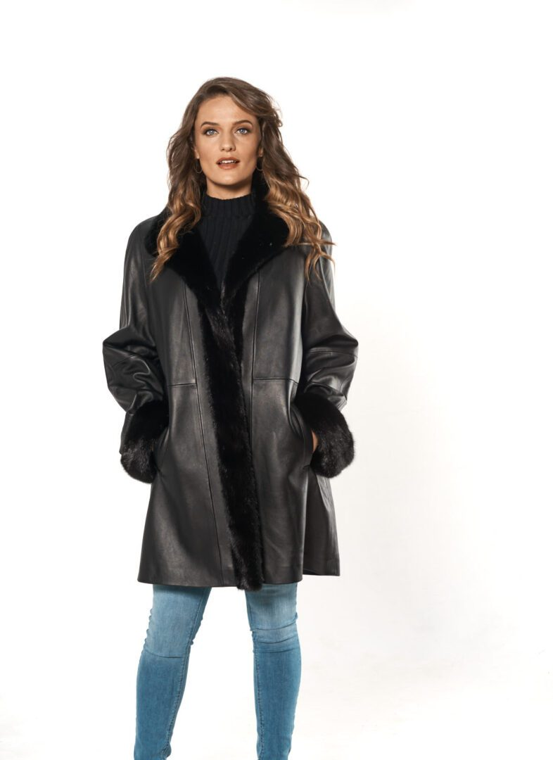 woman wearing black leather and black mink tuxedo and cuff stroller