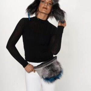 woman in black and white wearing gray fur trooper hat and fanny pack