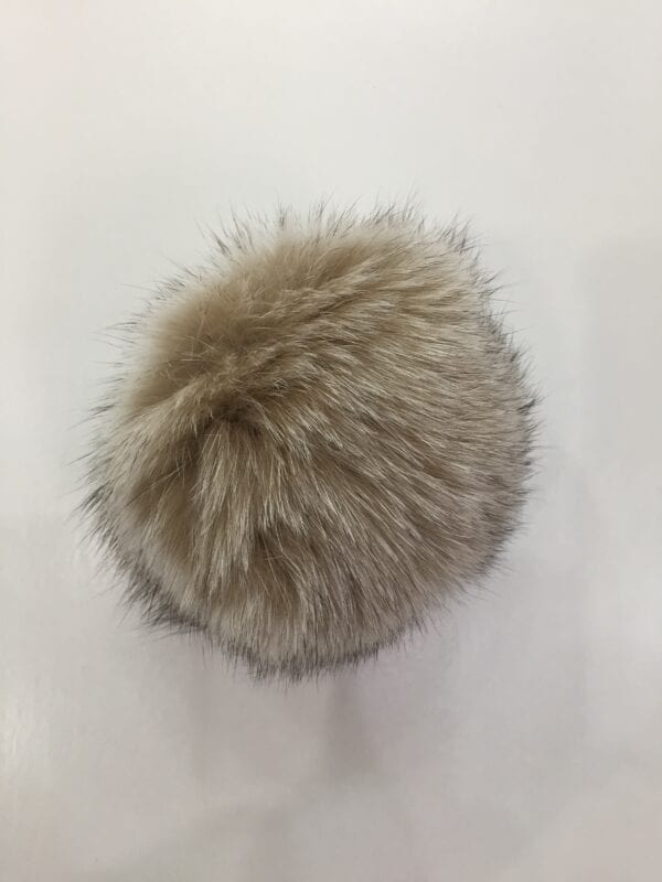 small photo of light brown fur pom hat topper