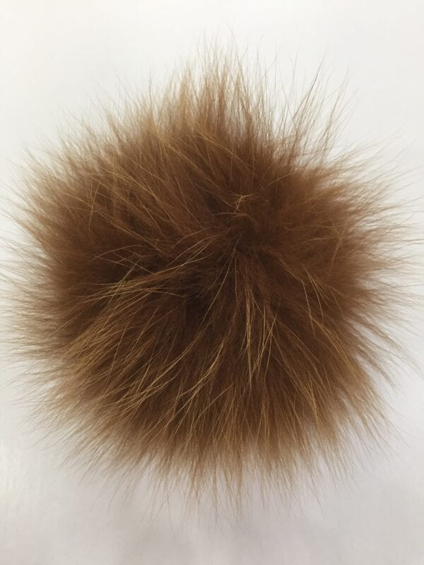 small photo of tan fur pom hat topper