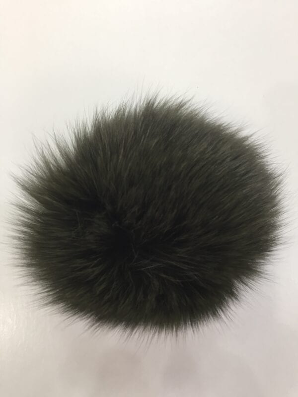 small photo of dark gray fur pom hat topper