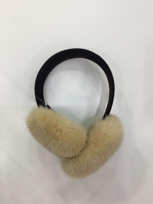 small photo of pair of dirty white fur earmuffs