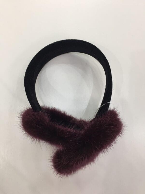 small photo of pair of purple fur earmuffs