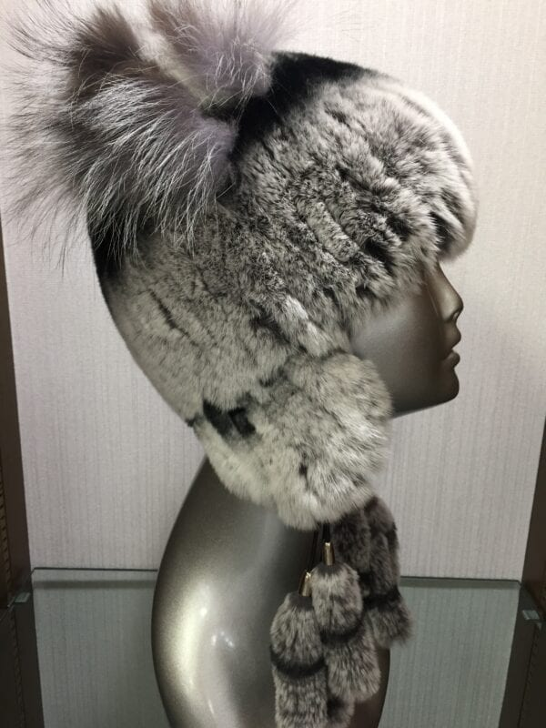 silver mannequin wearing gray fur pom hat right