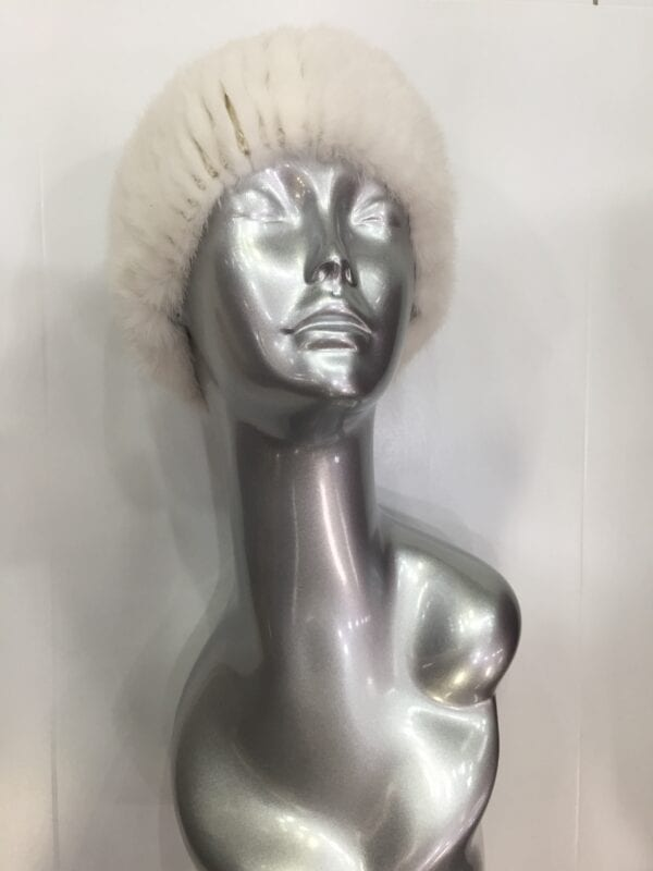 small photo of silver mannequin wearing white fur headband