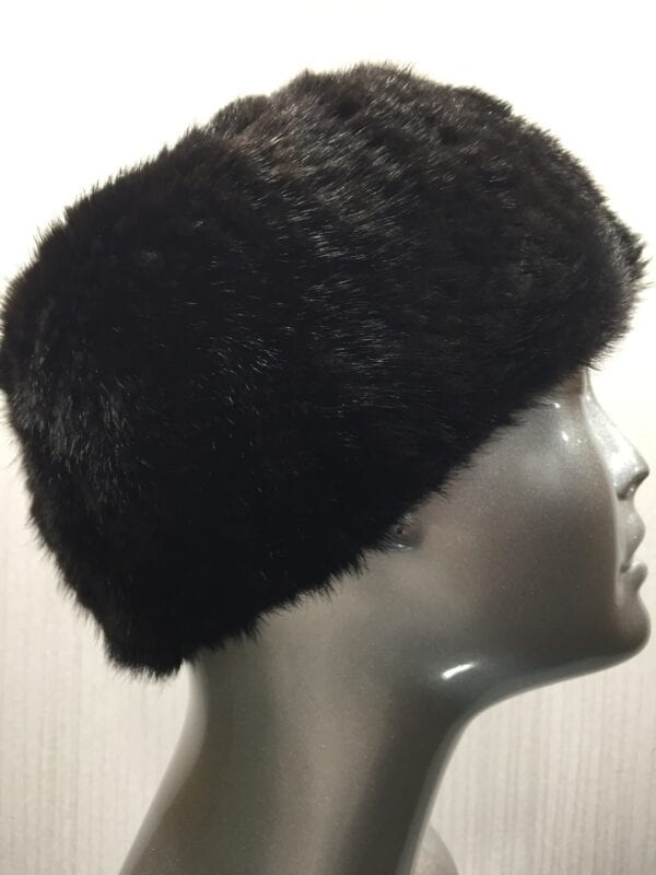 mannequin wearing black knitted mink headband right close