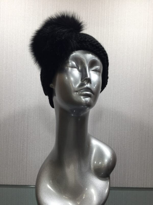 silver mannequin with black knit headband with black fur