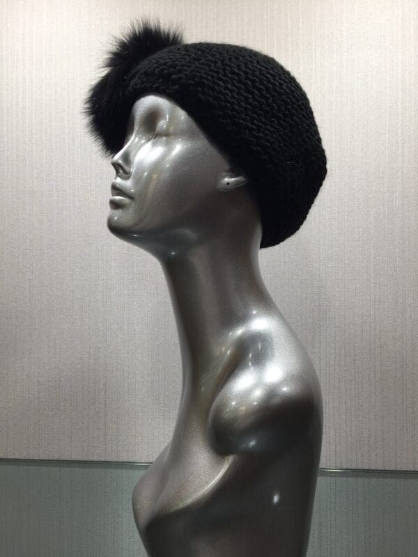 silver mannequin with black knit headband with black fur left