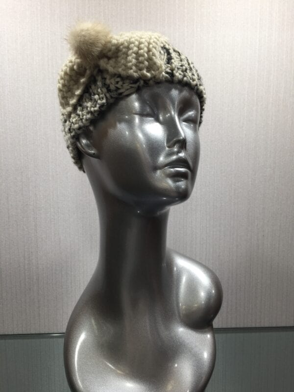 silver mannequin wearing knit headband with ribbon