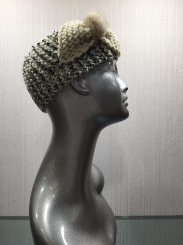 silver mannequin wearing knit headband with ribbon right