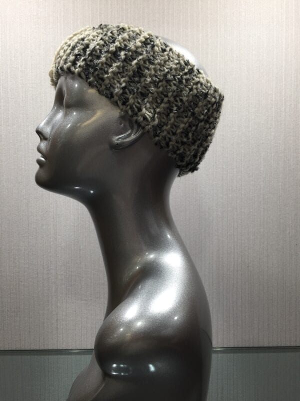 silver mannequin wearing knit headband with ribbon left