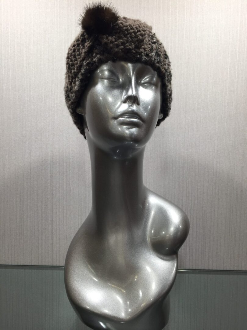 mannequin wearing knit headband with knit bow and mink
