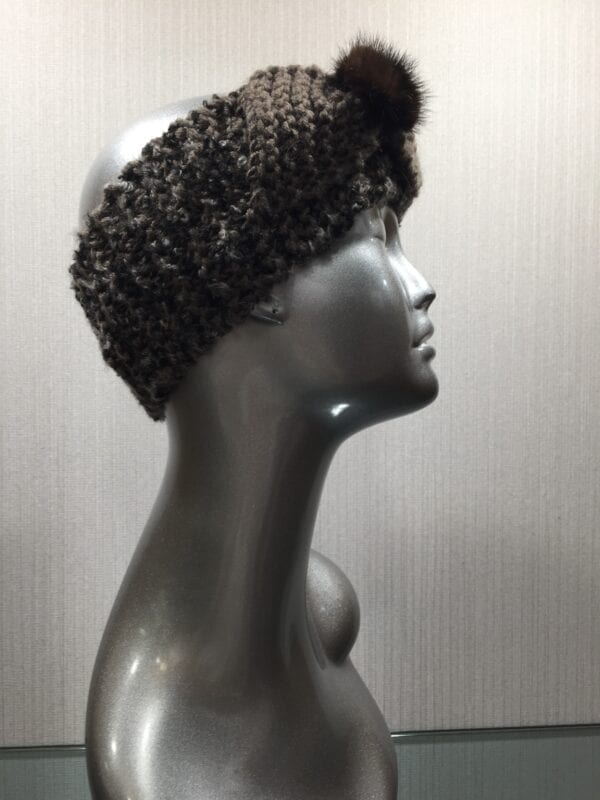 silver mannequin wearing knit headband with small fur flower right