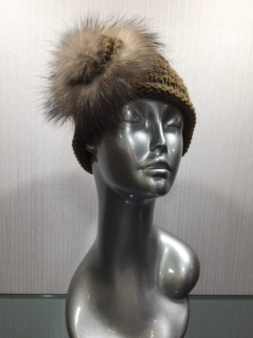 mannequin wearing brown knit headband with fox flower