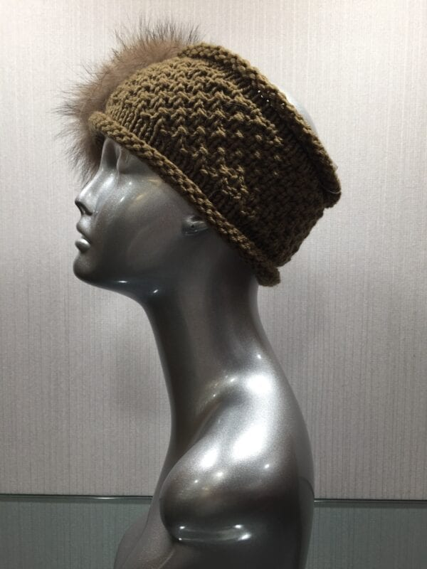 silver mannequin with knit brown headband with fur flower left