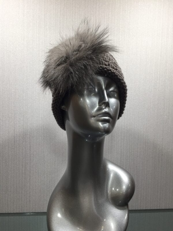 silver mannequin with gray headband with gray fur