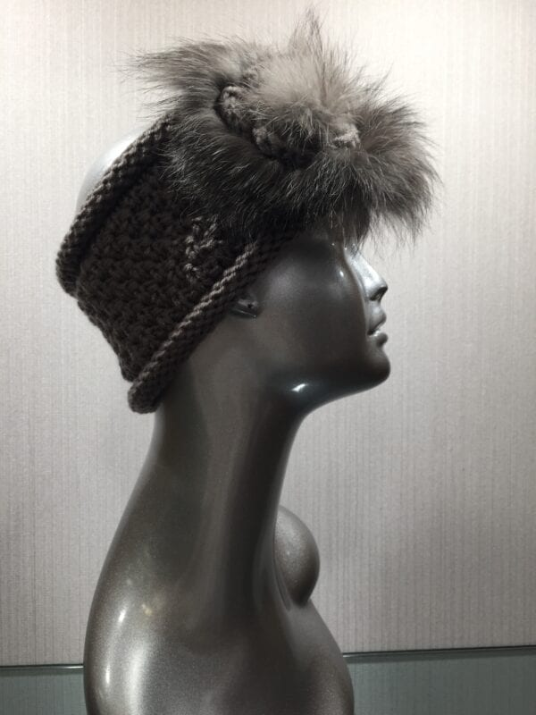 silver mannequin with gray headband with gray fur right