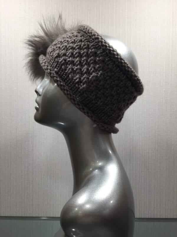 silver mannequin with gray headband with gray fur left
