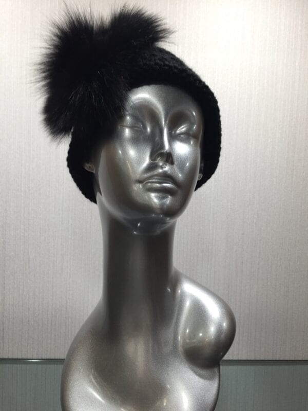 silver mannequin wearing black knit headband with fur