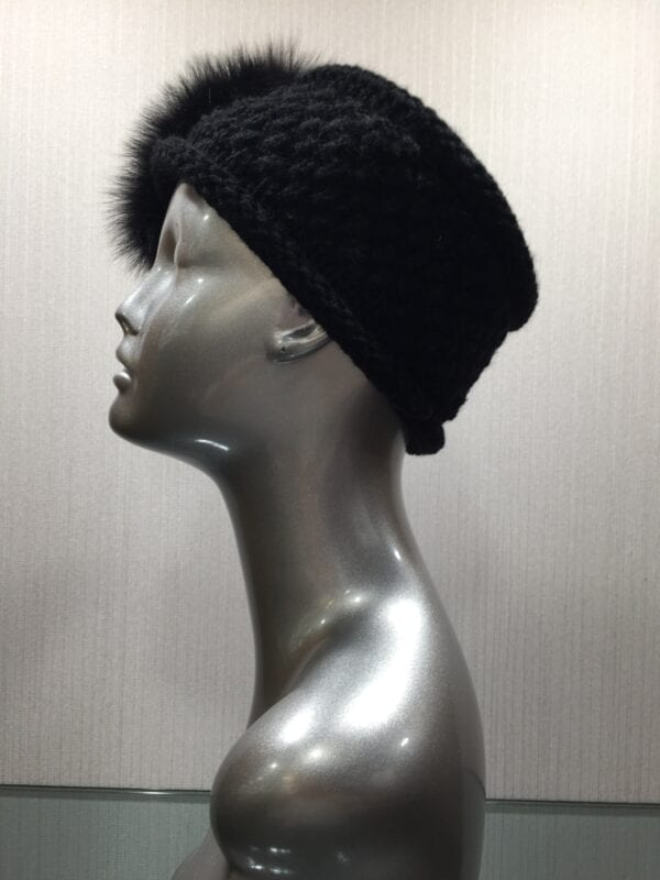 silver mannequin wearing black knit headband with fur left