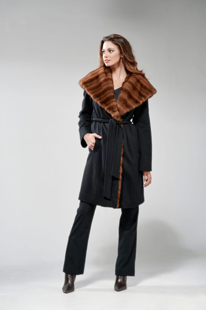 woman wearing black cashmere and wild mink hooded wrap