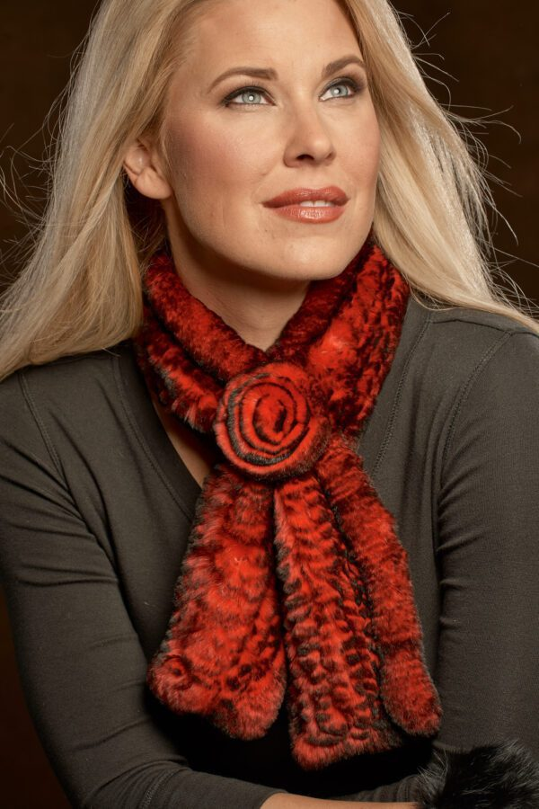 woman wearing knitted rex rosette scarf