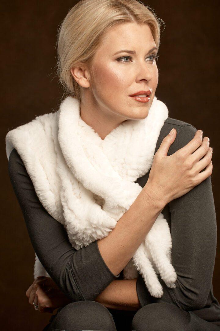 woman wearing rex tassel scarf