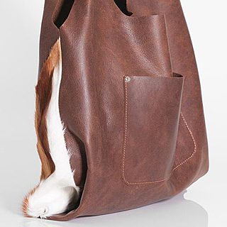 small photo of brown leather bag with white fur