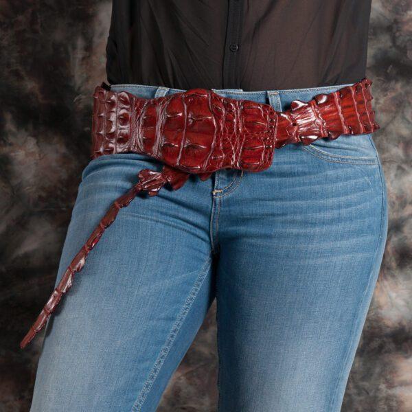 person with jeans and kulu crocodile fashion belt