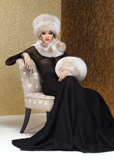 sitting woman wearing black dress with fur